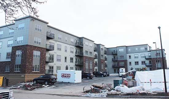 Monday, Oct. 26 was move-in day for half of the residents at Buffalo's brand-new Alo Apartments, and the parking lot was busy with storage units, vehicles and trailers being unloaded. Thirty housing units were ready, and the additional 30 units will...