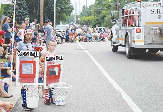 These two youngsters appear to have it all figured out, a new way to get more candy during the 130th annual Annandale Fourth of July parade on Thursday, July 4. Many of those in the parade distributing candy tried their best to score a basket. See...