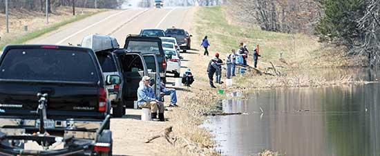 Monday, May 18 was the first day Minnesotans could make non-essential trips since Governor Tim Walz first implemented the Stay-at-Home order on March 27. Pictured above are people who made their way to the shore of Schmidt Lake off County Rd. 34...
